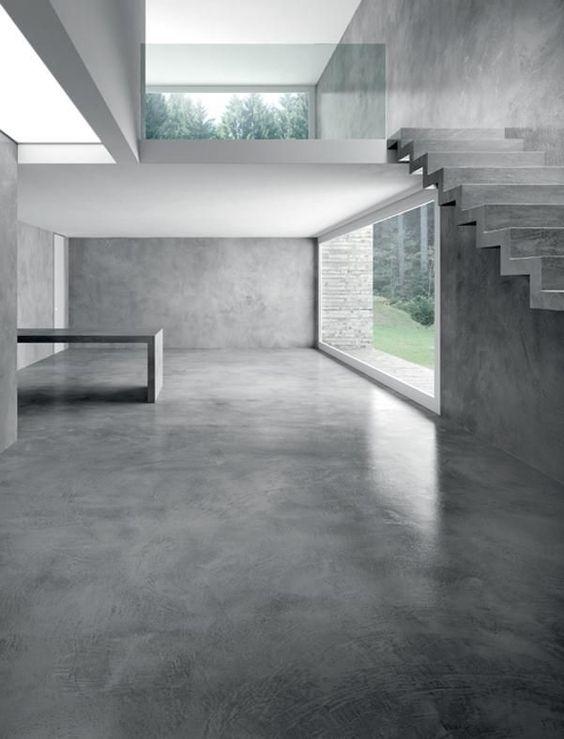 Intérieur contemporain et design avec un sol en béton lissé